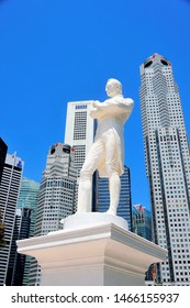 Singapore - July 12 2019: Stone statue of Sir Stamford Raffles with backdrop of skyscrapers and blue sky to commemorate the founding 200th anniversary of modern Singapore