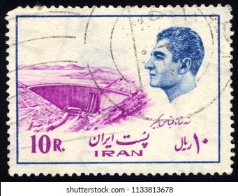 SINGAPORE - JULY 14, 2018: A stamp printed in Iran shows Shah Abbas Kabir Dam, Buildings and industrial plants, Mohammad Reza Shah Pahlavi serie, circa 1975