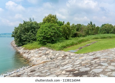 Singapore - july 15, 2018:  Storm drain to sea. Due to the amount of rain Singapore has a large amount of Storm Drains.