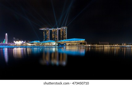 SINGAPORE - JULY 16 : The Art Science Museum at night with Beautiful laser show at the marina bay waterfront.