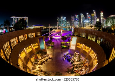 SINGAPORE - JULY 16: Night scene of the Esplanade at Marina Bay with the Singapore skyline in the background July 16, 2015. The area comes alive at night with vibrant shows and attractions.