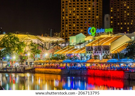 67c382716087 SINGAPORE - JULY 18   Colorful light building at night in Clarke Quay