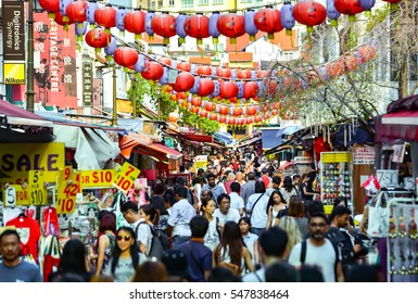 SINGAPORE - JULY 2016: Shopping crowd in Chinatown, Singapore