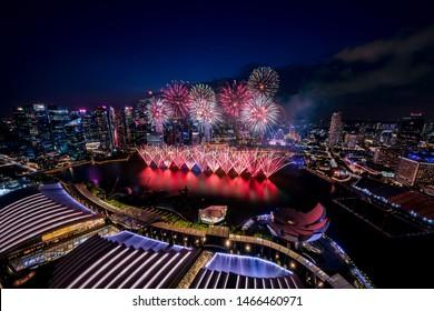 Singapore - July 2019: NDP Rehearsal Firework at Marina bay area, Singapore. Singapore Celebrates National day with beautiful fireworks.