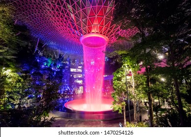 Singapore / Singapore - July 24, 2019: Jewel Changi Airport Rain Vortex, the largest indoor waterfall in the world and the centerpiece of Jewel Changi Airport by night
