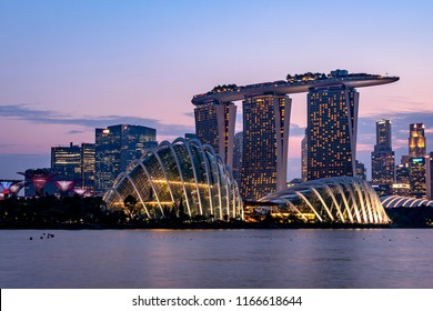 SINGAPORE - July 25,2018: The Singapore skyline at night, dominated by the giant flower domes and Marina Bay Sands Hotel, in Gardens By The Bay