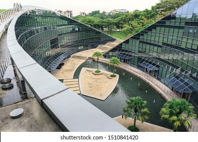 SINGAPORE - JULY 26, 2016_School of Art, Design & Media at Nanyang Technological University campus, Singapore. The place is a stunning piece of award-winning architecture situated in a wooded valley.
