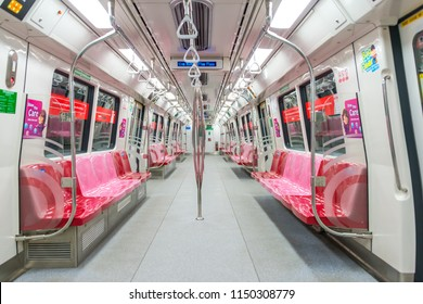 SINGAPORE - July 28, 2018 : Cabin interior of MRT train. The Mass Rapid Transit or MRT is a rapid transit system forming the major component of the railway system in Singapore