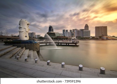 Singapore - July 30, 2017: The Mer lion fountain and marina bay sands during sunrise is famous landmark and very popular for photographers and tourists of Singapore city