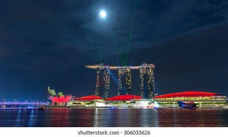 SINGAPORE - JULY 31, Beautiful laser show at Marina Bay Sand on July 31, 2015 in Singapore. Marina Bay Sand is the attraction of Marina Bay.