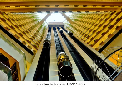Singapore - July 31st 2018: Perspective view up the elevator shaft in the lobby of the Pan Pacific Hotel in Marina Bay