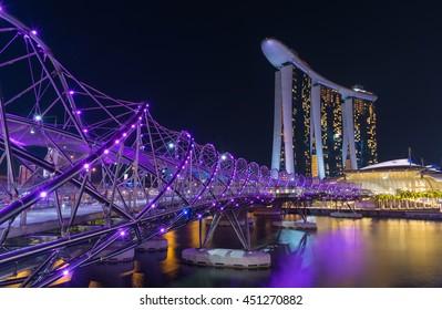 SINGAPORE - JULY 8, 2016 : Helix Bridge and Marina Bay Sand Hotel at night time landmark in Singapore.