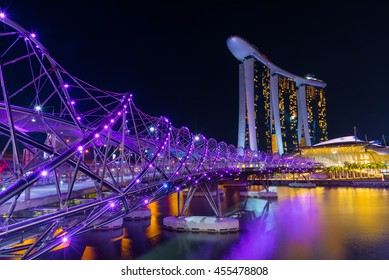 SINGAPORE - JULY 8, 2016 : Landscape of Singapore Skyline and view of skyscrapers on Marina Bay at night time.