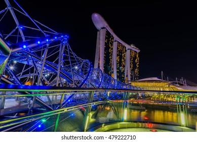 SINGAPORE - JULY 8,2016 : Helix Bridge and Marina Bay Sand Hotel at night time landmark in Singapore.