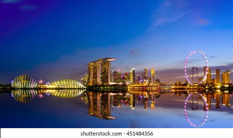SINGAPORE - JULY 9, 2016 : Singapore Skyline and view of skyscrapers on Marina Bay at twilight time.