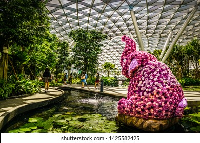 Singapore - Jun 11,  2019: Topiary Walk at Jewel. Jewel Changi Airport is a mixed-use development at Changi Airport in Singapore, opened in April 2019.