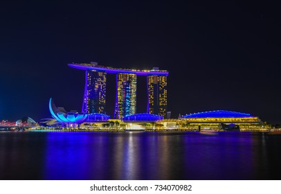 Singapore - Jun 12, 2017. Modern buildings at night in Singapore. Singapore is one of the original Four Asian Tigers, but has surpassed its peers in terms of GDP per capita.