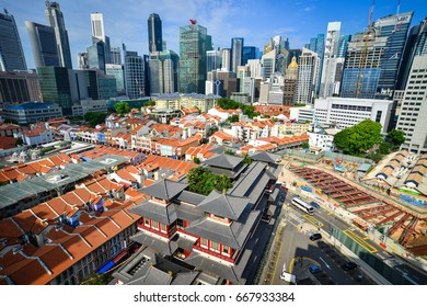 SINGAPORE - JUN 12, 2017. Tooth Relic Temple with cityscape in Singapore. The temple is based on the Tang dynasty architectural style and built to house the tooth relic of the historical Buddha.