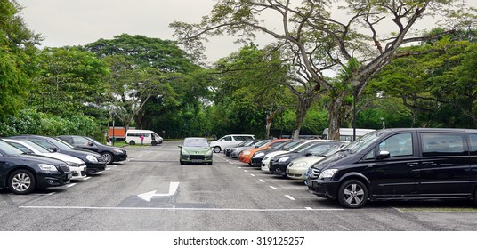 Singapore - Jun 22, 2015. Car parking lot at bus terminal in Singapore. The per-capita car ownership rate in Singapore is 12 cars per 100 people (or 1 car per 8.25 people).
