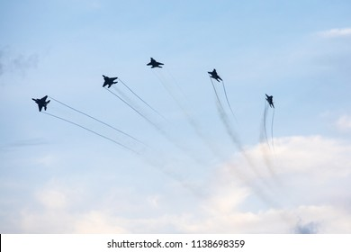 Singapore - Jun 23, 2018: Singapore airforce fighter jets flying low over the Marina Bay district as part of the Singapore National Day Parade (NDP) rehearsals.