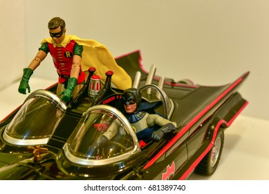 SINGAPORE - JUN 27,2017 : Studio shot of Batman and Robin.Robin is standing inside the car with batman sitting beside him.