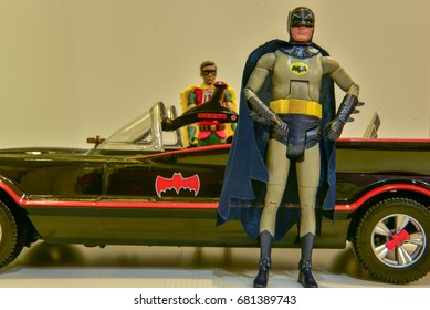 SINGAPORE - JUN 27,2017 : Studio shot of Robin and Batman.Batman standing outside the car with blur background of Robin at the back  .