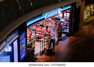 Singapore Jun2020 Top down view of retail store Watsons, an essential business allowed to open during covid-19 coronavirus outbreak. Employee is at work, displaying products at the store front.