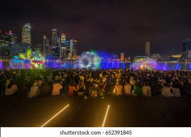 Singapore, Singapore - June 02, 2017: A brand new free-to-public outdoor light and water show displayed over the water at the Event Plaza in front of The shopper at Marina Bay, Singapore