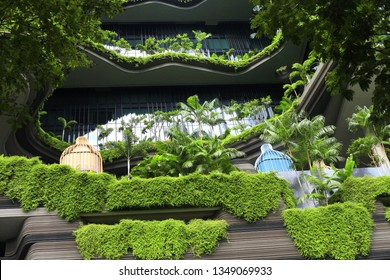 Singapore, Singapore - June 05, 2017 :   Green nature facade on modern futuristic building in Singapore city