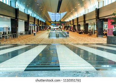 SINGAPORE – June 10, 2018:  View of the very long hallways and travelators of Changi Airport in Singapore, South East Asia