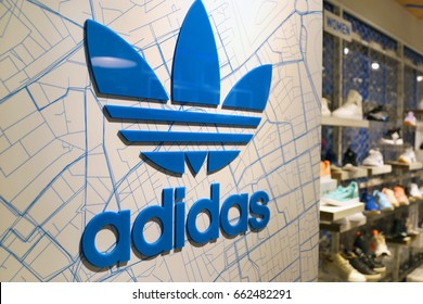 SINGAPORE, JUNE 11, 2017: A sign for an Adidas retail store, Adidas is a German corporation that designs footwear and clothing.