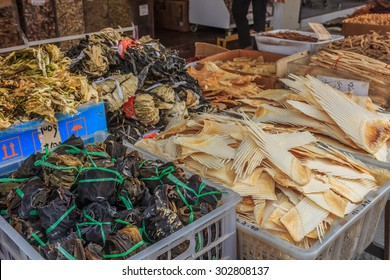 Singapore, Singapore - June 16, 2013: Baskets with dried shark fin, herbs and fish products at a traditional Chinese medicine shop in Chinatown