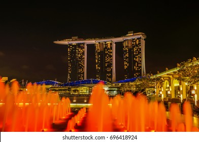 SINGAPORE - JUNE 17, 2014 :  Marina Bay Sands Hotel with light fountains in foreground at night in Singapore