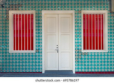 Singapore - JUNE  17 2015: Singapore local vintage buiding close up door photo with floral pattern wallpaper tile in Chinatown Singapore