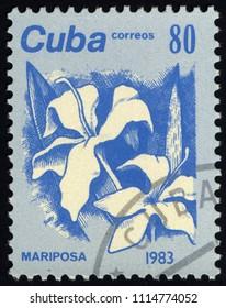SINGAPORE - JUNE 18, 2018: A stamp printed in Cuba, shows Mariposa flower, circa 1983