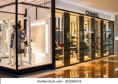 SINGAPORE - JUNE 19: Chanel Store in Marina Bay Sands Shopping mall, Singapore on June 19, 2014. Chanel is a high fashion house, specializes in clothes, luxury goods and fashion accessories.