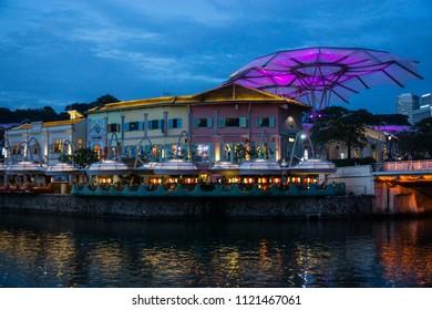 Singapore, Singapore - June 1st, 2018: Beautiful night view of Clarke Quay with Singapore river