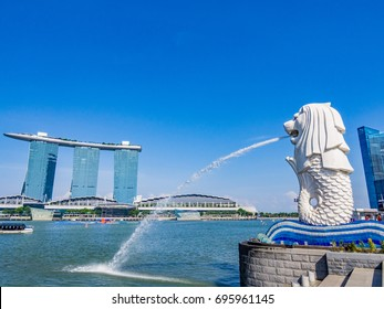 SINGAPORE - JUNE 20, 2014: Merlion fountain in front of the Marina Bay Sands hotel in Singapore. Singapore is a sovereign city-state in Southeast Asia.