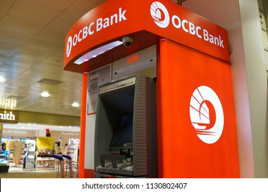 SINGAPORE - JUNE 20, 2018 : ATM of OCBC Bank in Changi Airport, Singapore. OCBC oversea Chinese Banking Corporation is a financial services organisation based in Singapore and offices in 18 countries.