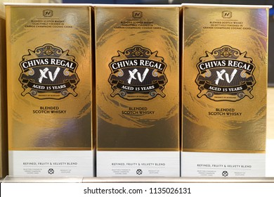 SINGAPORE - JUNE 20, 2018 : Chivas Regal Blended Scotch Whisky on display shelf in Changi Airport Terminal. Chivas Regal is a blended Scotch whisky produced by Chivas Brothers.