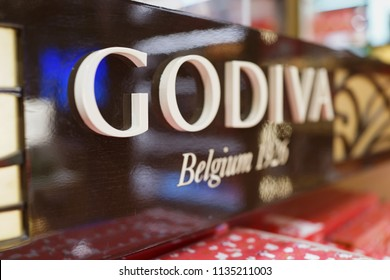 SINGAPORE - JUNE 20, 2018: GODIVA Chocolate sign in Changi Airport Terminal 2. GODIVA Chocolatier is a Belgian manufacturer of premium fine chocolates and related products.