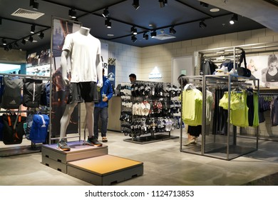 SINGAPORE - JUNE 20, 2018: Interior of Adidas retail store in Changi Airport Terminal 2, Singapore. Adidas is a German corporation that designs footwear and clothing.