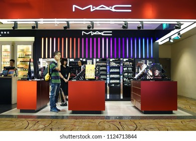 SINGAPORE - JUNE 20, 2018: MAC Cosmetics Shop in Changi Airport Terminal 2. MAC Cosmetics was founded in Toronto, Ontario, Canada in 1984 and became part of the Estée Lauder Companies in 1998.
