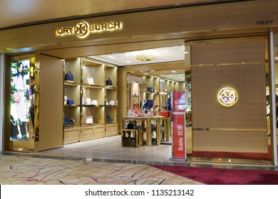 SINGAPORE - JUNE 20, 2018: The outer facade of the Tory Burch boutique in Changi Airport. Tory Burch is an American fashion label owned, operated and founded by American designer Tory Burch.