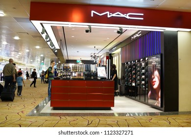 SINGAPORE - JUNE 20, 2018: View of MAC Cosmetics Shop in Changi Airport Terminal 2. MAC Cosmetics was founded in Toronto, Ontario, Canada in 1984 and became part of the Estée Lauder Companies in 1998.