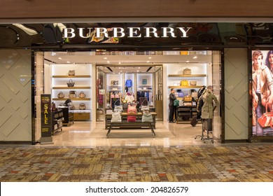 SINGAPORE - JUNE 20: Burberry store in Changi Airport, Singapore on June 20, 2014. It is a British luxury fashion house, distributing clothing, fashion accessories, fragrances and cosmetics.
