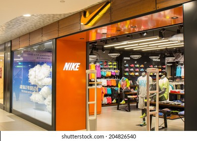 SINGAPORE - JUNE 20: Nike store in Changi Airport, Singapore on June 20, 2014. It is an American company, engaged in the design and manufacturing of footwear, apparel, equipment and services.