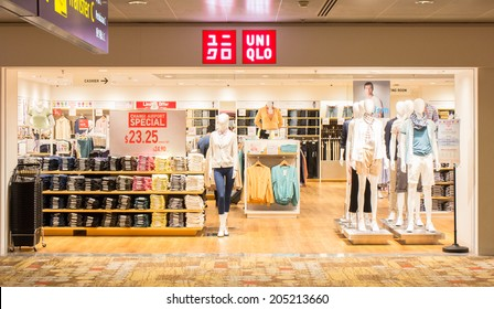 SINGAPORE - JUNE 20: Uniqlo store in Changi Airport, Singapore on June 20, 2014. UNIQLO is a Japanese casual wear designer, manufacture and retailer operating worldwide.