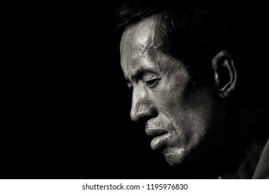 SINGAPORE - JUNE 2011: An unidentified chinese man feels tired and fatigued. Asian old man is having pain and grief. China man have headache and stress. Depression and sadness of a man.