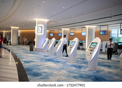 SINGAPORE - June, 2019: a traveller at the self check-in kiosk at Terminal 4, Singapore Changi Airport. Changi Airport is a major civilian airport that serves Singapore.